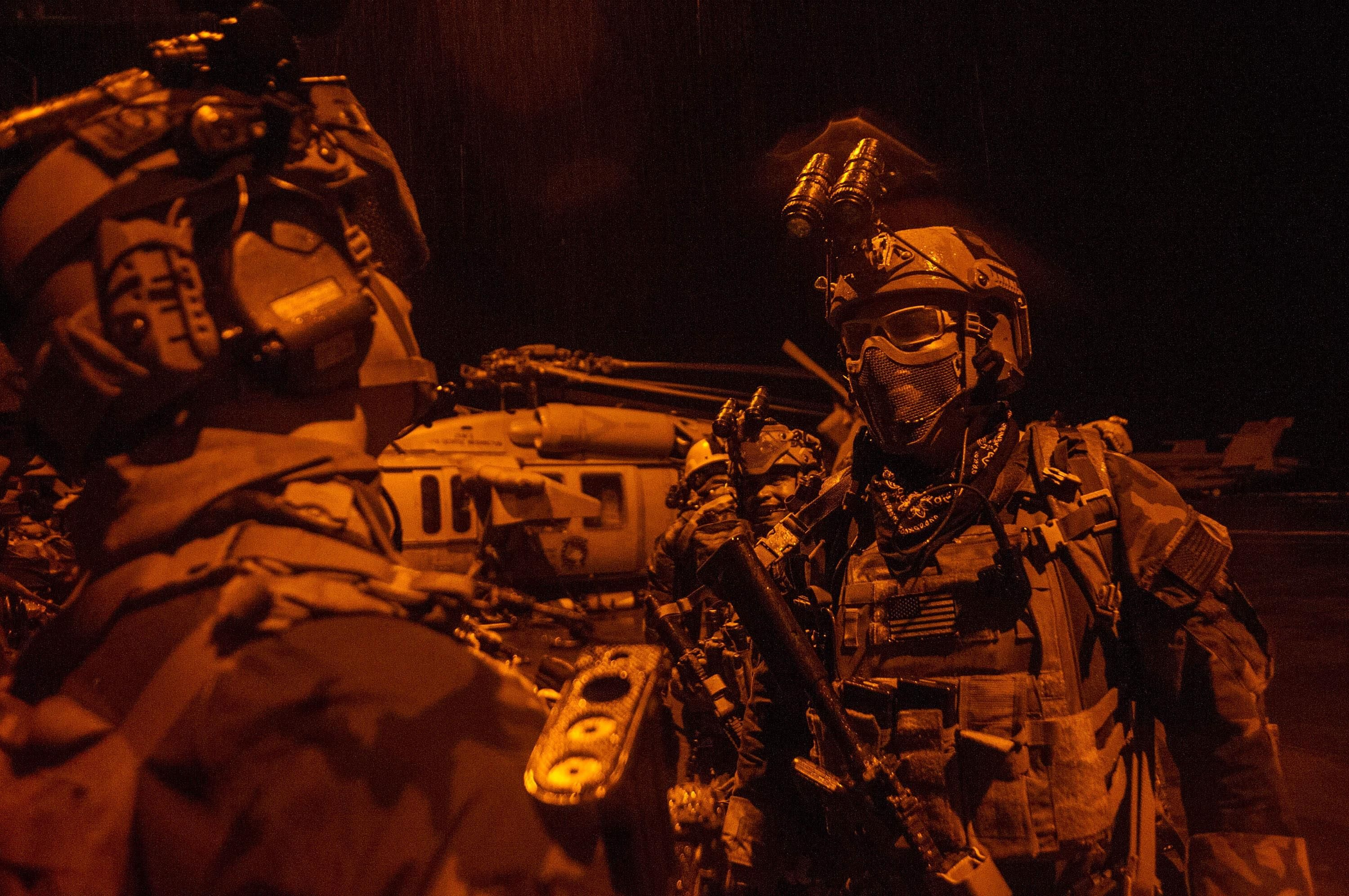 SEAL u MARSOC operators before a training exercise aboard the USS