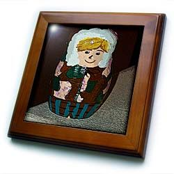 Russian Stacking Doll Painted as a Boy in a Parka of Camouflage in Brown and Greens with Blonde Hair Framed Tile