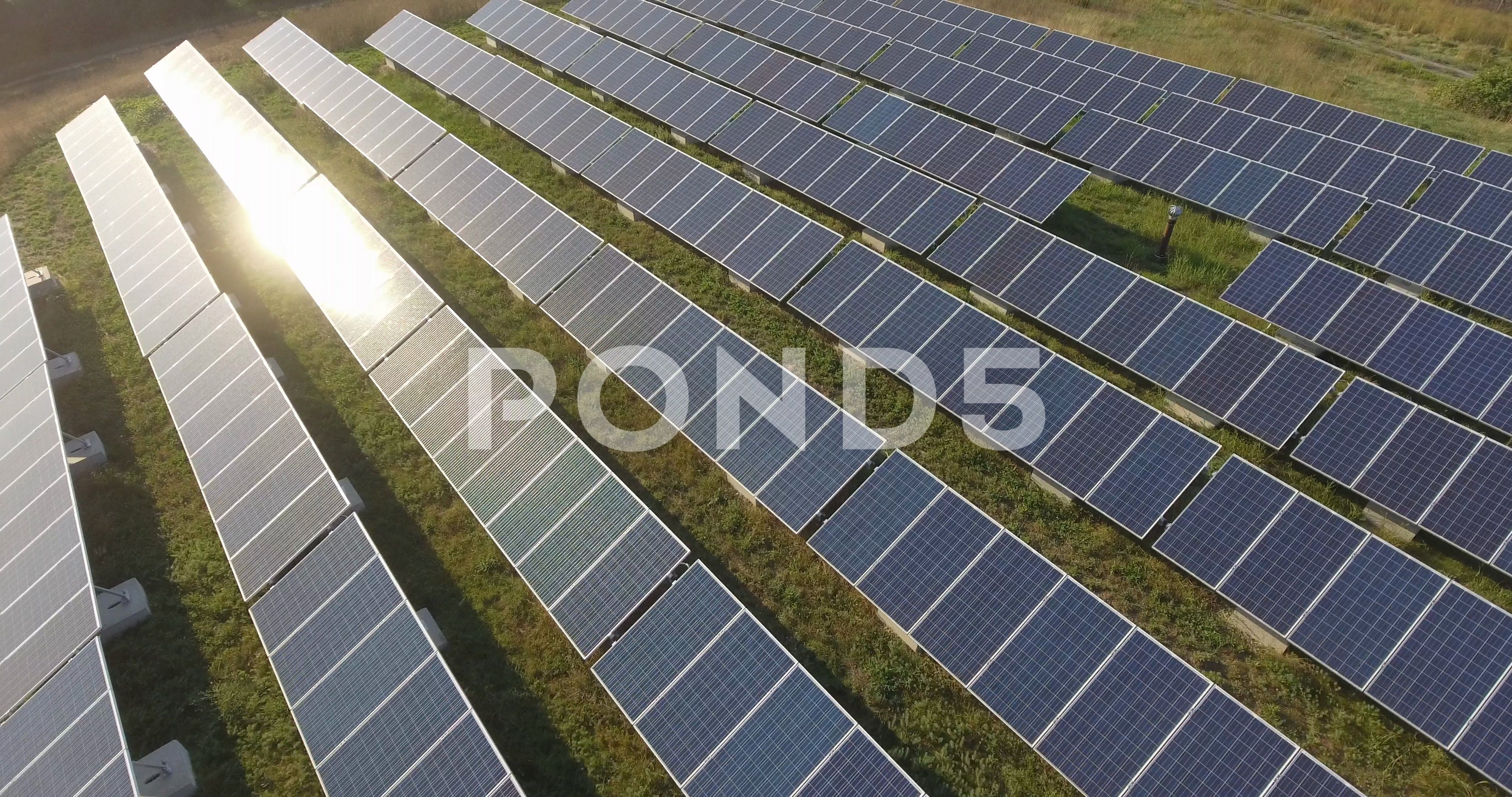 Solar Panels Array At Solar Farm Alternative Clean Renewable Energy 4k Drone Stock Footage Solar Farm Alternative Solar Solar Farm Solar Solar Panels