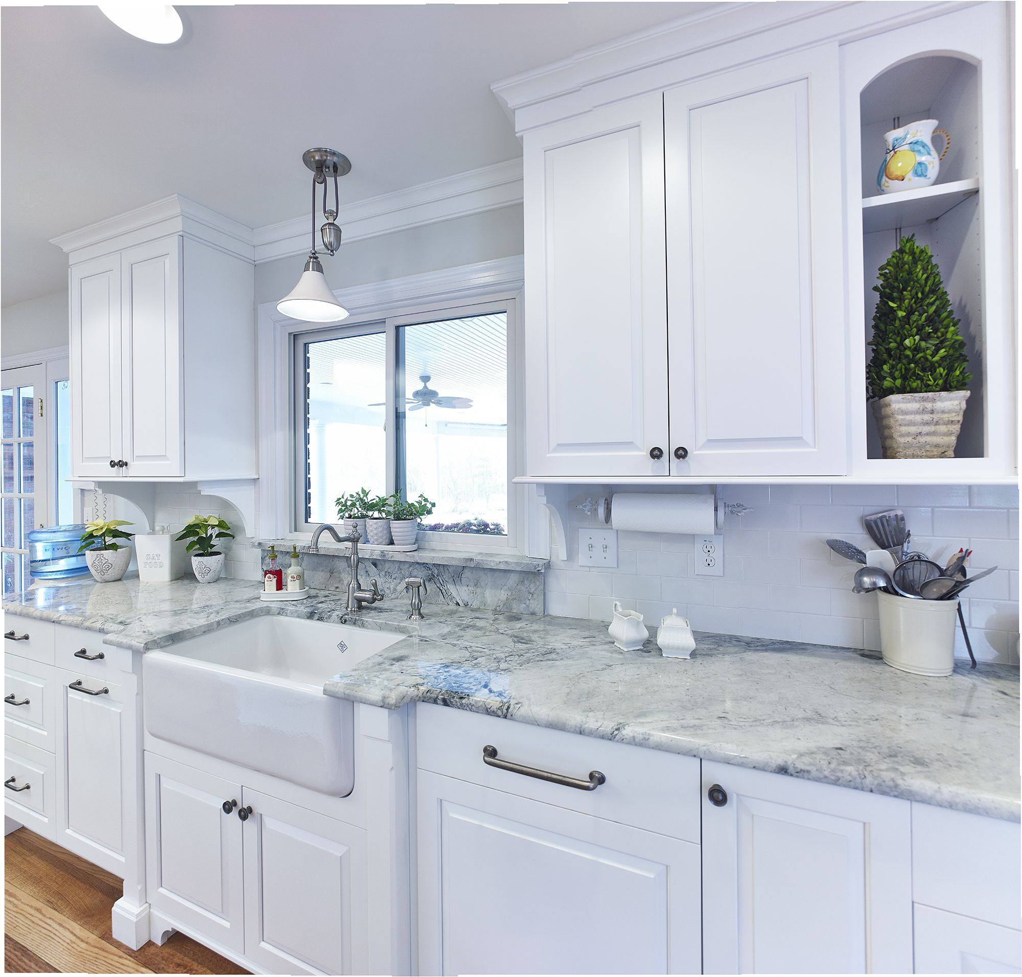 Custom white kitchen with farmhouse sink and super white granite top ...