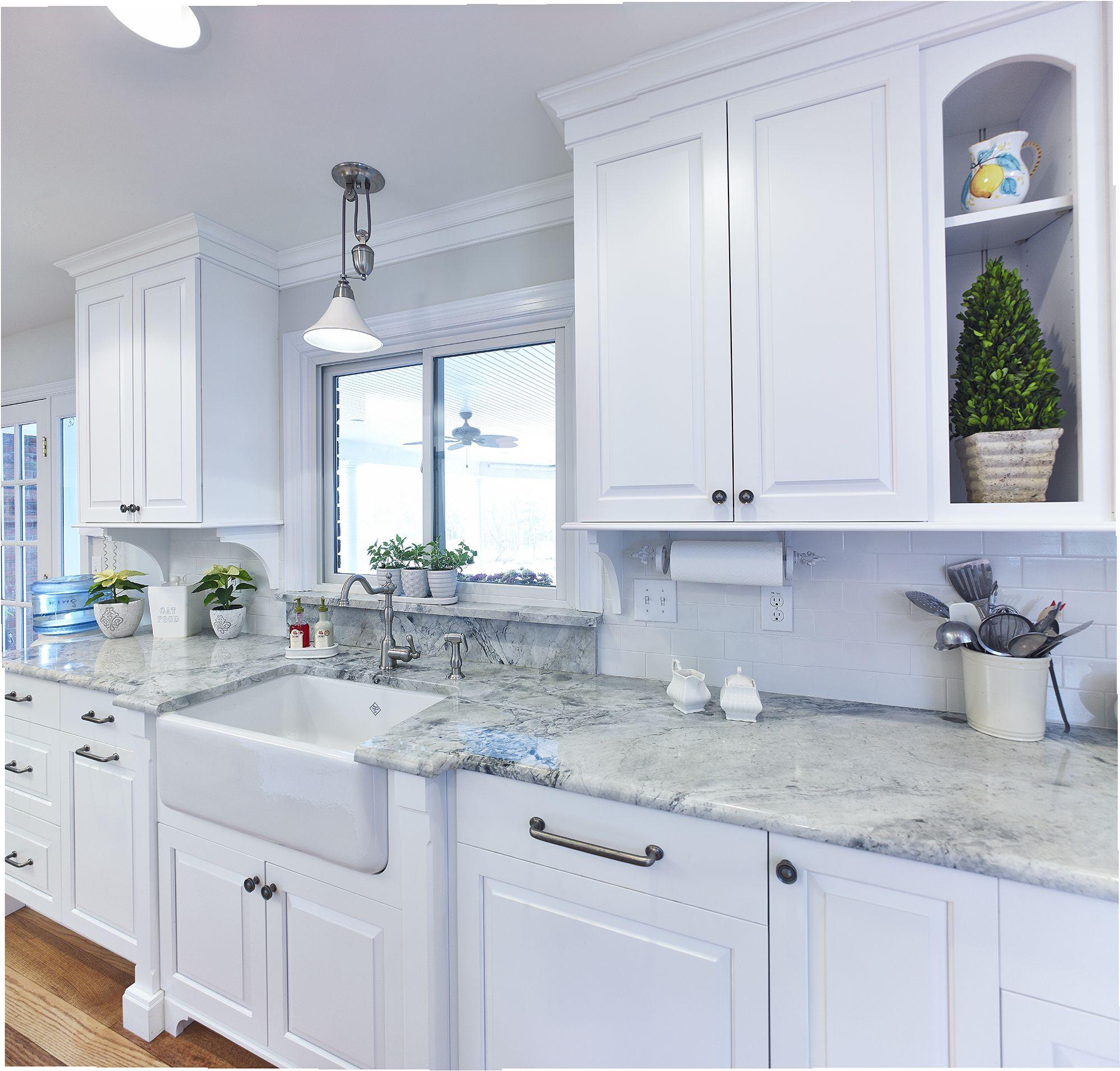 Custom white kitchen with farmhouse sink and super white