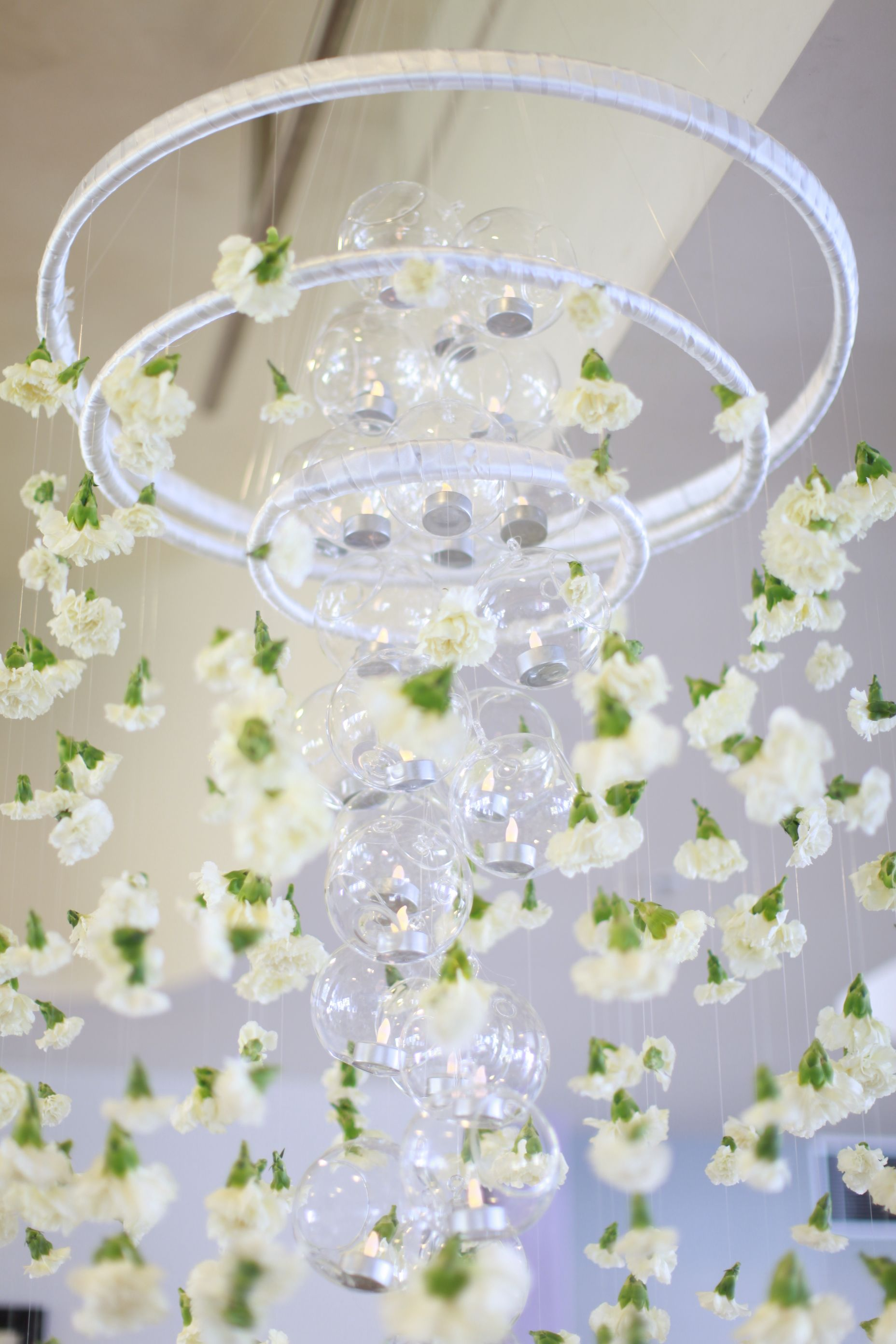 Glass bubbles containing tea light candles look beautiful as your ...