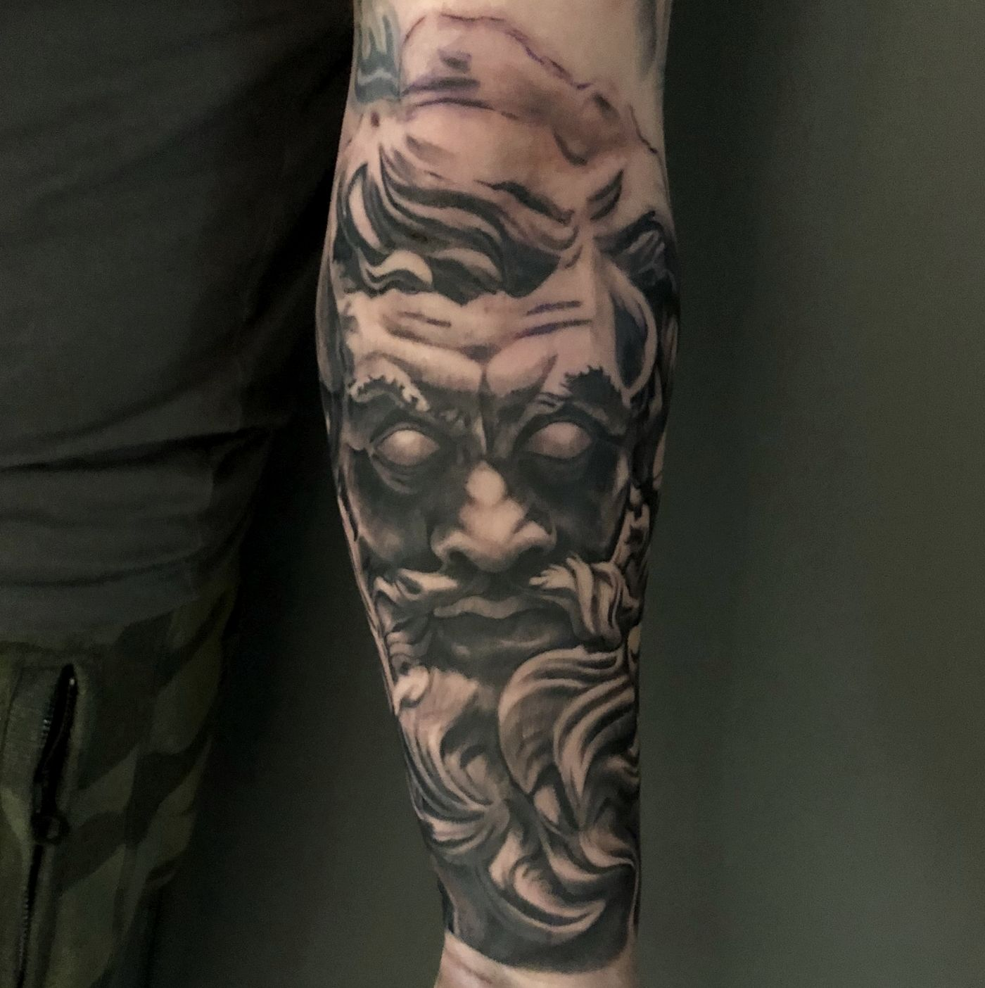 Ancient statue of Zeus sleeve arm tattoo in black and grey realism, London, UK | #blackandgreytattoos #realistictattoos #sleevetattoos #sculpturetattoos #zeustattoo