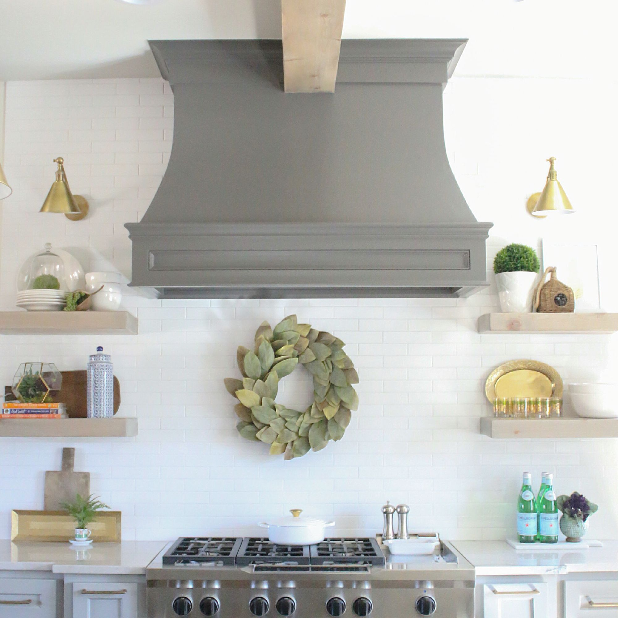 Dreamy white and gray kitchen white subway tile backsplash and love the color of this beam with the gray hood and bright white subway tile dailygadgetfo Choice Image