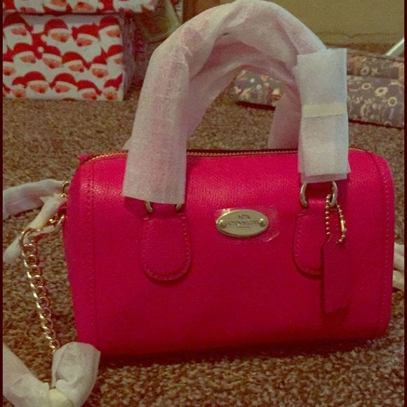 NWT hot pink coach mini crossbody purse Brand new with tags! Originally $250! Gold accents and chain. Coach Bags Crossbody Bags