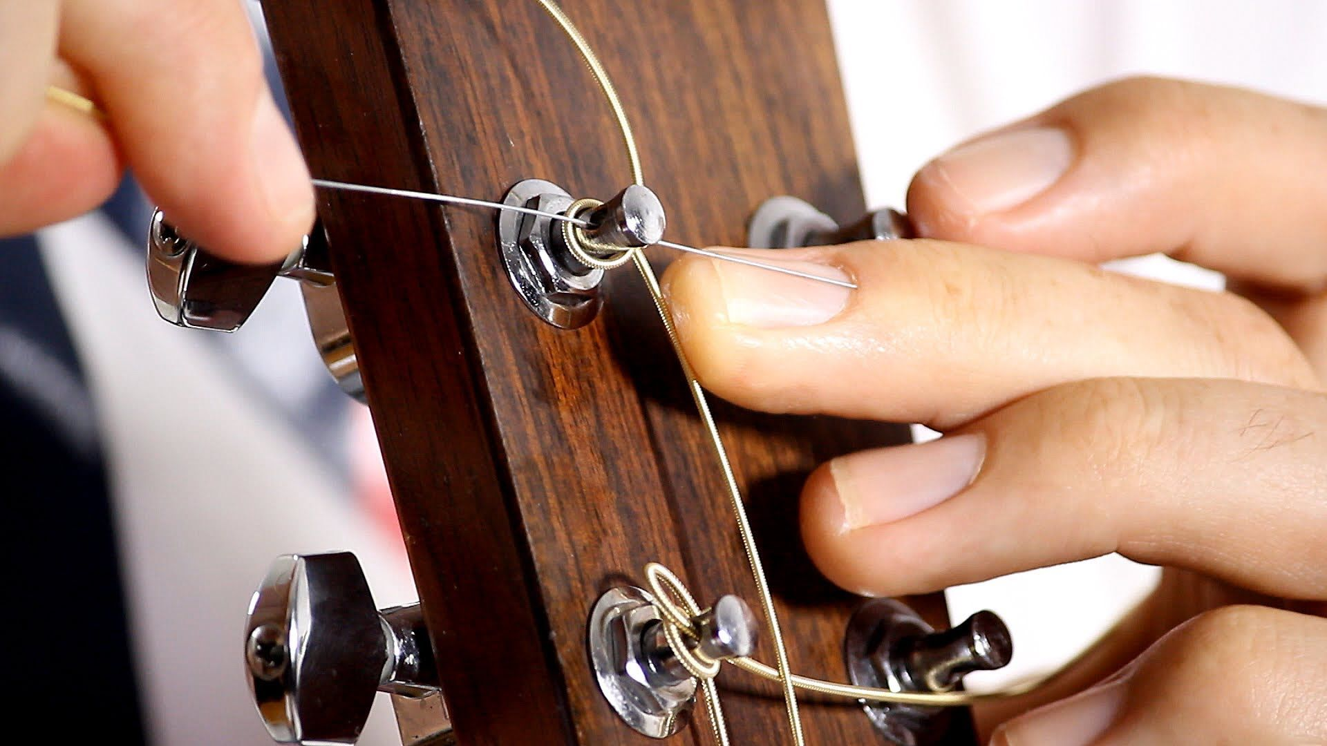 How to put on Guitar Strings Acoustic Guitar Maintenance