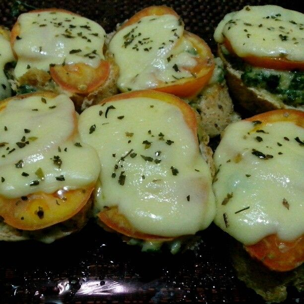 Baked wheat baguette layered with spinach & tomatoes topped with mozzarella cheese & basil