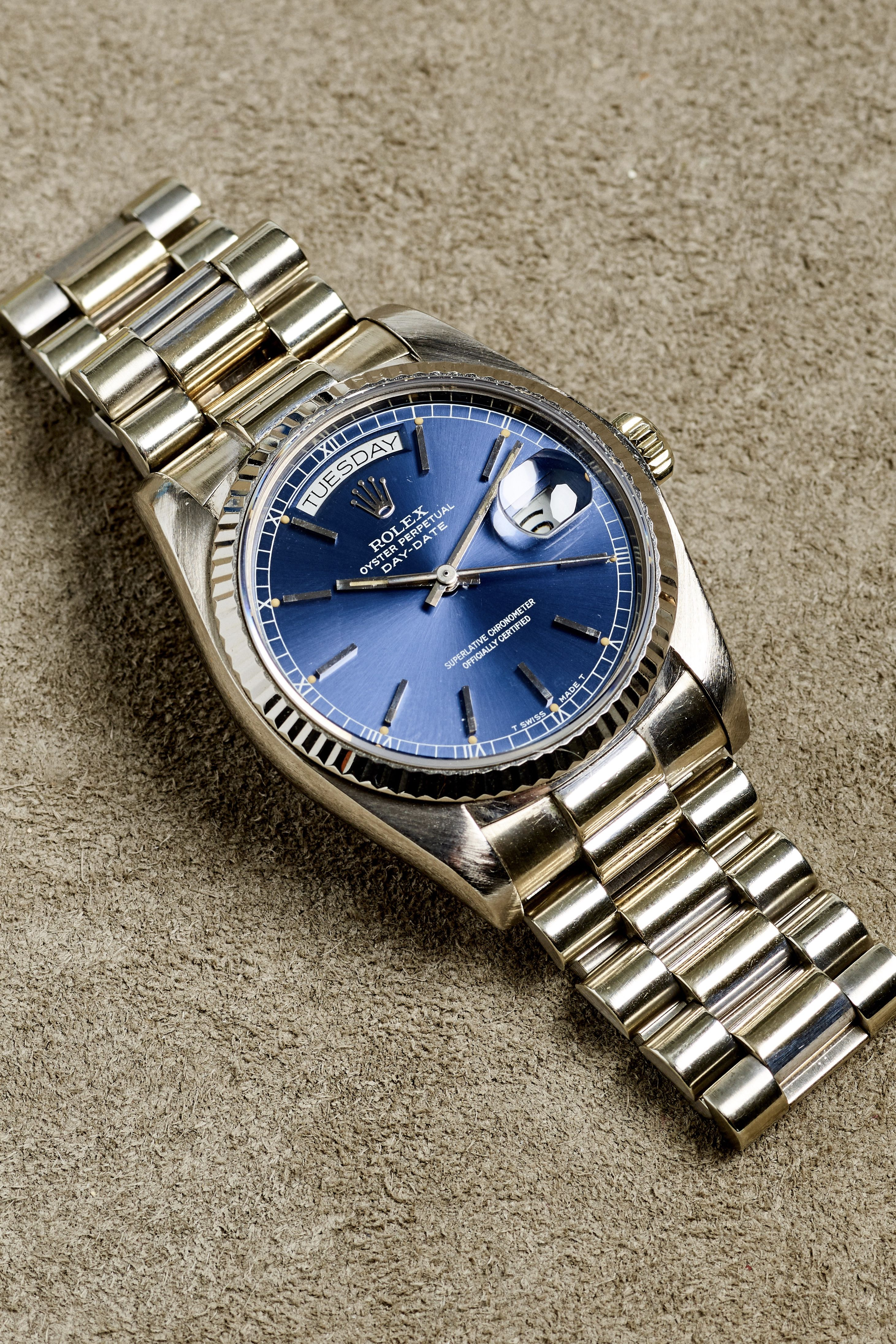 63ec9bce5 This Rolex 18K white gold day-date president watch features a striking  cobalt blue dial with stick hour markers and a roman numeral minute track.