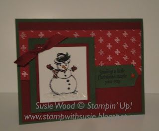 Stampin' Up!-  It's an adorable snowman from the 'Christmas Magic' set!  And check out the snow, using the White MIca Flakes!