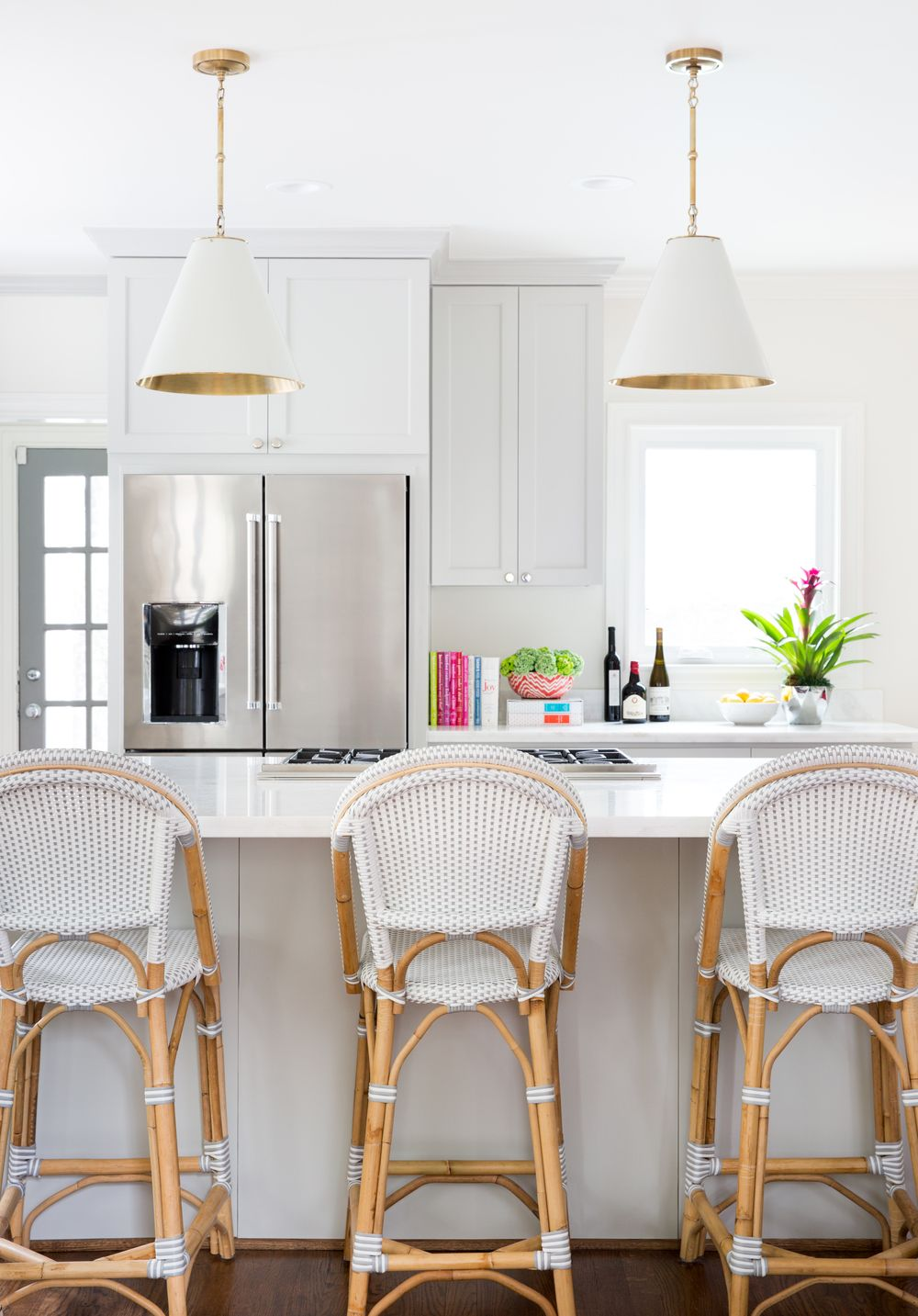 12 Best French Bistro Chairs For Your Home   Kitchen Remodel     White Kitchen French Bistro Chairs via Jennifer Barron Interiors