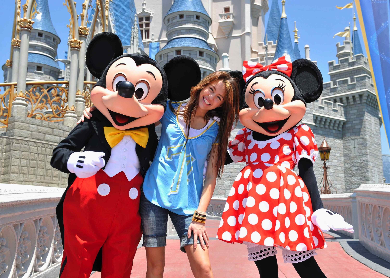 Mickey & Minnie with a celebrity guest Miley Cyrus near Cinderella Castle
