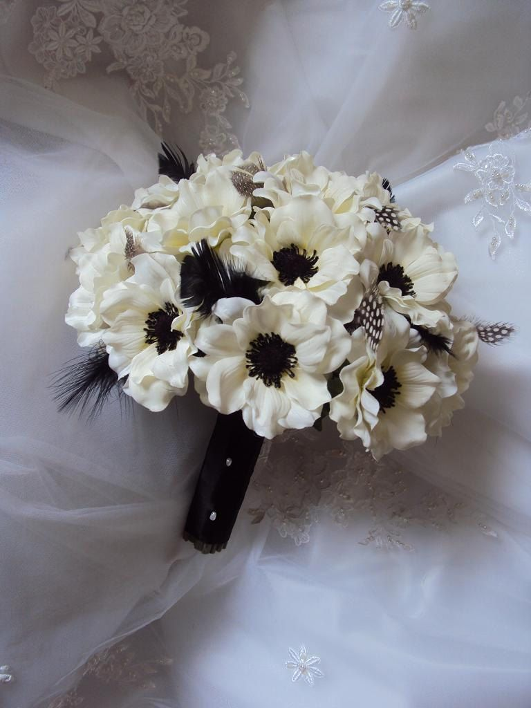 Silk ivory anemones wedding bouquet accented with black ostrich silk ivory anemones wedding bouquet accented with black ostrich guinea feathers with matching anemone boutonniere izmirmasajfo