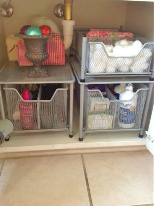 15 ways to organize under the bathroom sink organizing bathroom vanity under sink bathroom for Under counter bathroom storage ideas