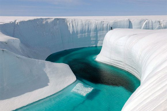 "This 2009 photo released by Extreme Ice Survey shows Birthday Canyon in Greenland furing the filming of ""Chasing Ice."""