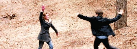 Emma Watson & Daniel Radcliffe High Five-ing after a scene well done-Harry Potter and the Deathly Hallows   Actually one of the cutest things ever.
