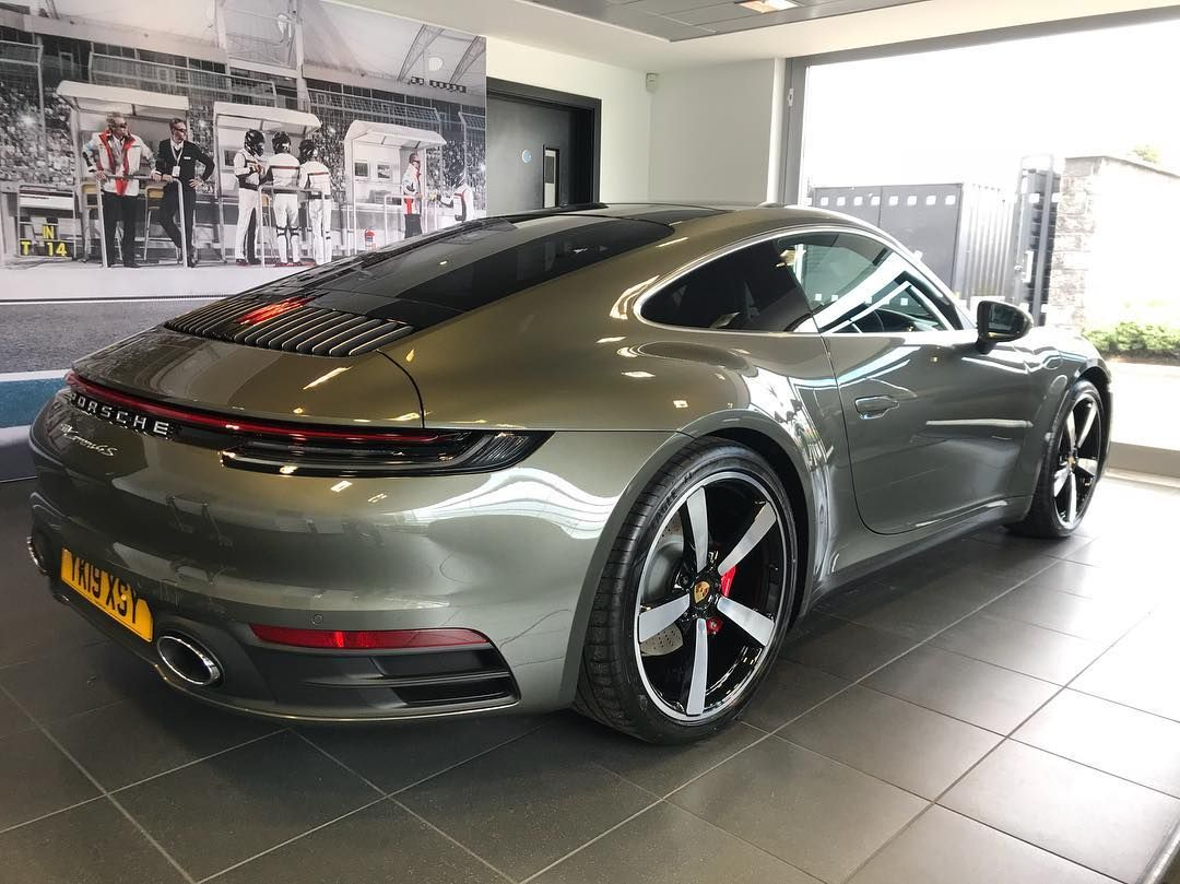 This 992 In The New Aventurine Green Metallic Looks Absolutely Stunning Customer Delighted With It When Colle Luxury Car Brands Porsche Cars Luxury Cars Audi