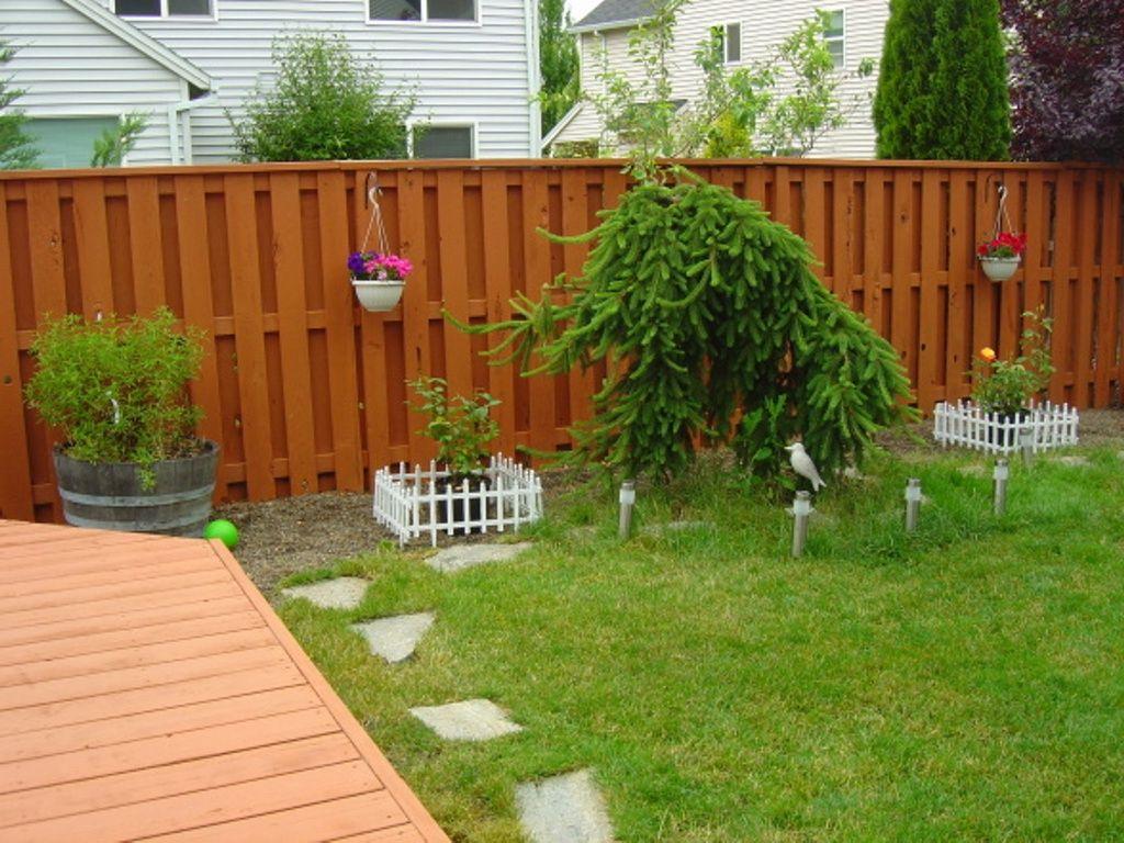 11 Clever Ways How To Improve Backyard Fences Backyard Fences Fence Paint Fence Paint Colours Backyard garden fence ideas
