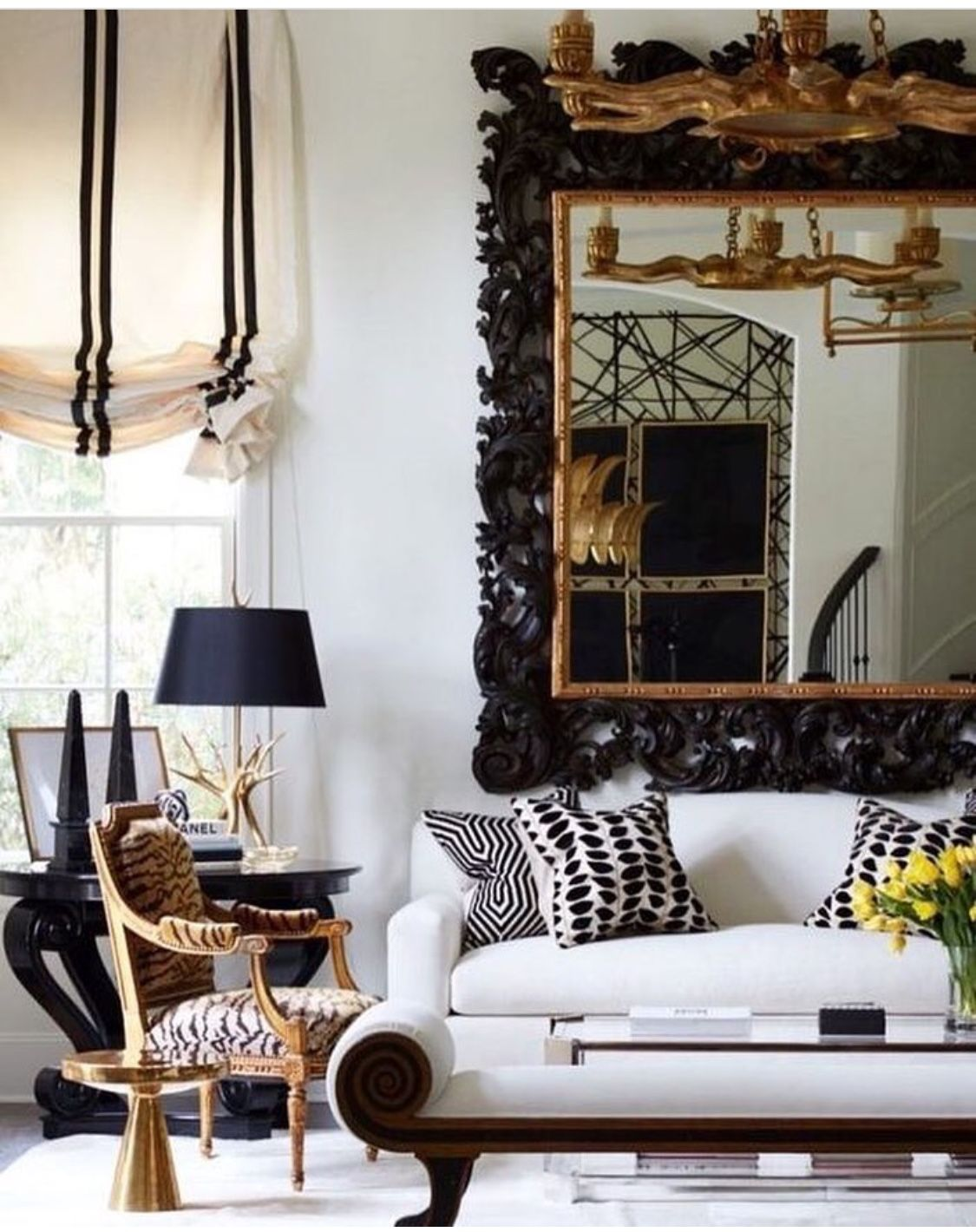 Black white and gold living room a little heavy handed but still fresh because of the crisp sofa and the beautiful blind