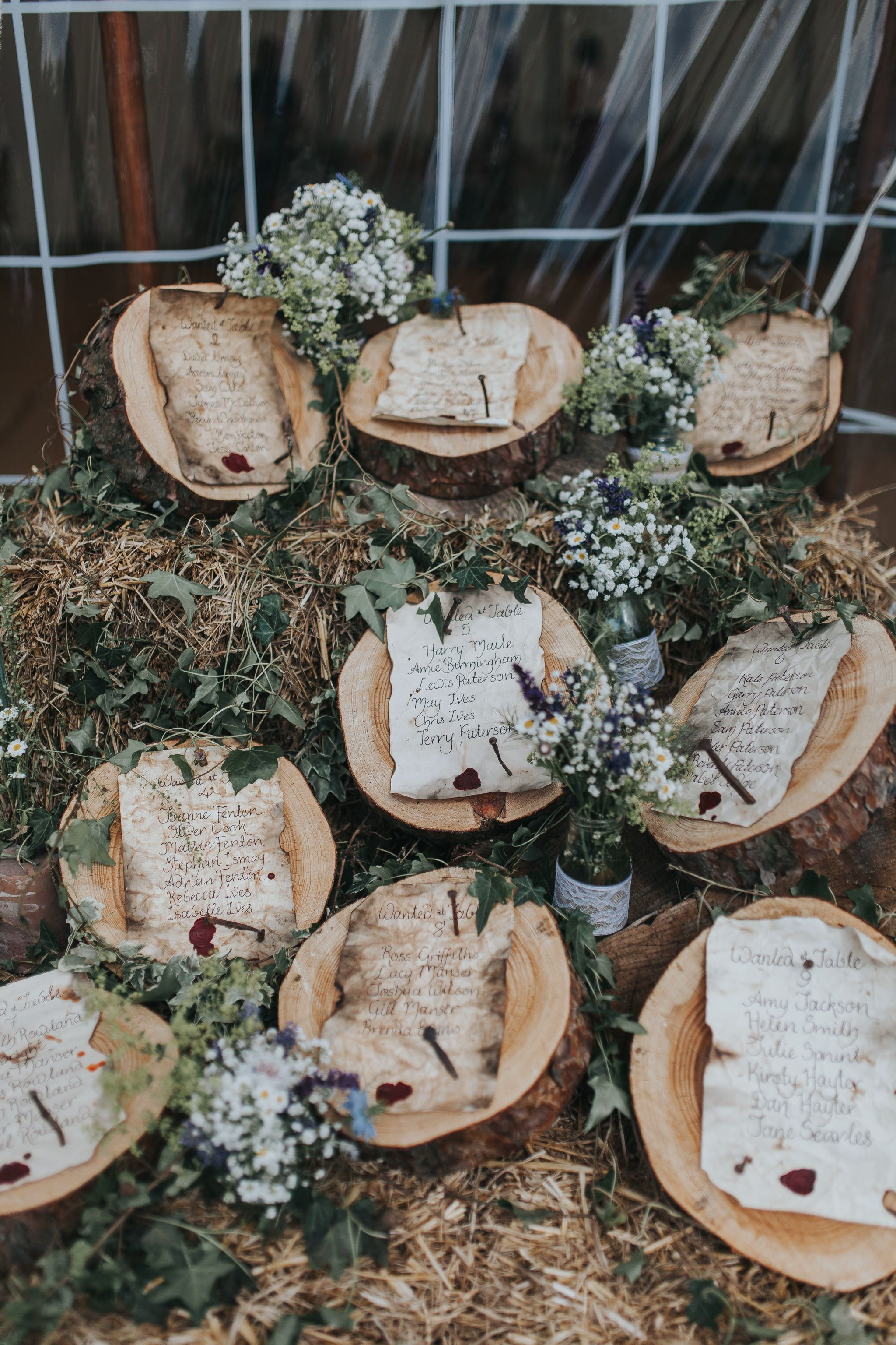 wedding table plan log wood slices rustic parchment scrolls
