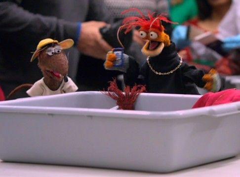 In A Muppets Christmas: Letters to Santa, Rizzo tells Pepe it's an airport rule that all electronic devices must go into the bin while going through security. Although upset, he loads into the bin his BlackBerry, as well as his BlueBerry, RaspBerry and a photo of Halle Berry.