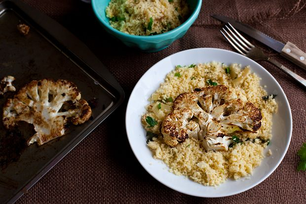 Moroccan Spiced Cauliflower 'Steak' and Couscous! Healthy and unbelievable. The thick, 'meaty' cauliflower slices are baked until golden with cumin, coriander and cinnamon.