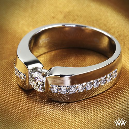 This Custom Mens Diamond Wedding Ring is set in Platinum and holds