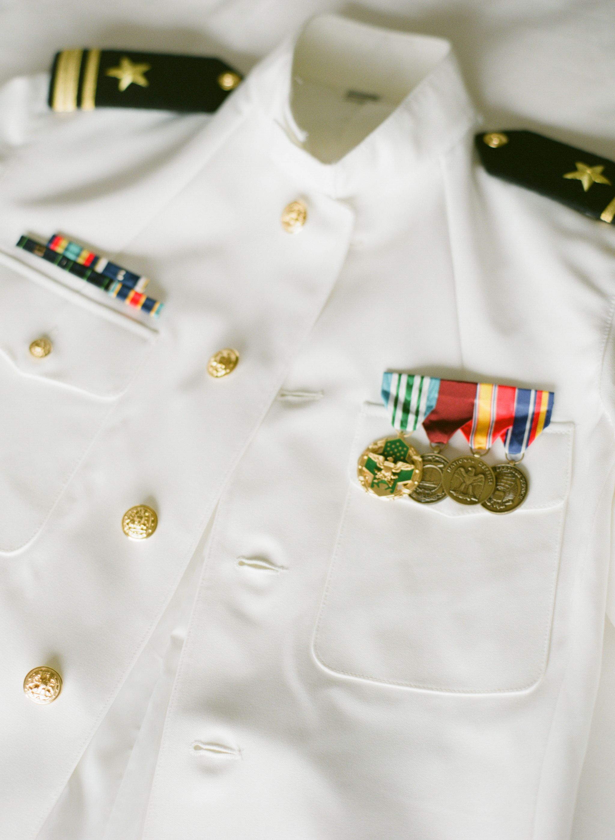 my grooms us navy dress whites adorned with medals and