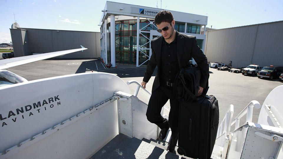 woow he really likes that black on black suit idea i agree with him
