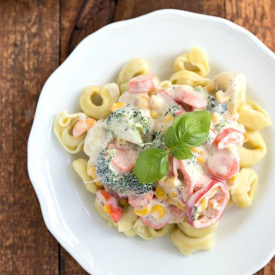 The creamiest (but secretly healthy) sauce covering fresh veggies and cheese-filled tortellini. Dinner in less than 20 minutes!