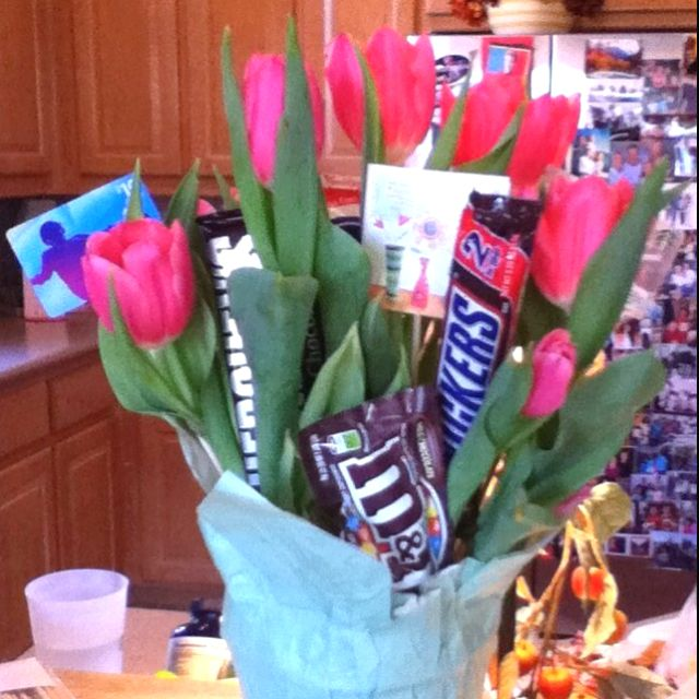 Not a repin!!! Actually just did this with my mom for a friend's birthday, but you could do it for any occasion. Pot of tulips with gift cards, candy, and a note taped to skewers and stuck in the dirt. SO cute!