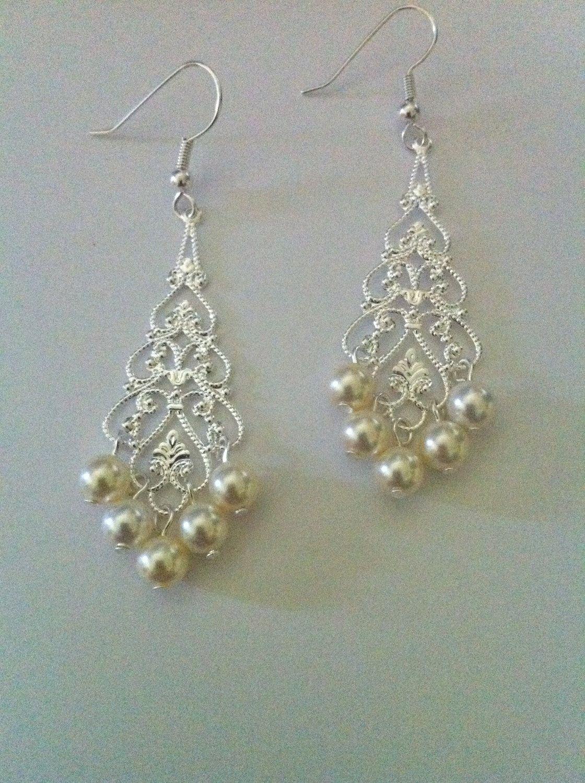Ivory Pearl Chandelier Earrings, Bridal Chandelier Earrings, Silver Chandelier Earrings 0100. $18.00, via Etsy.