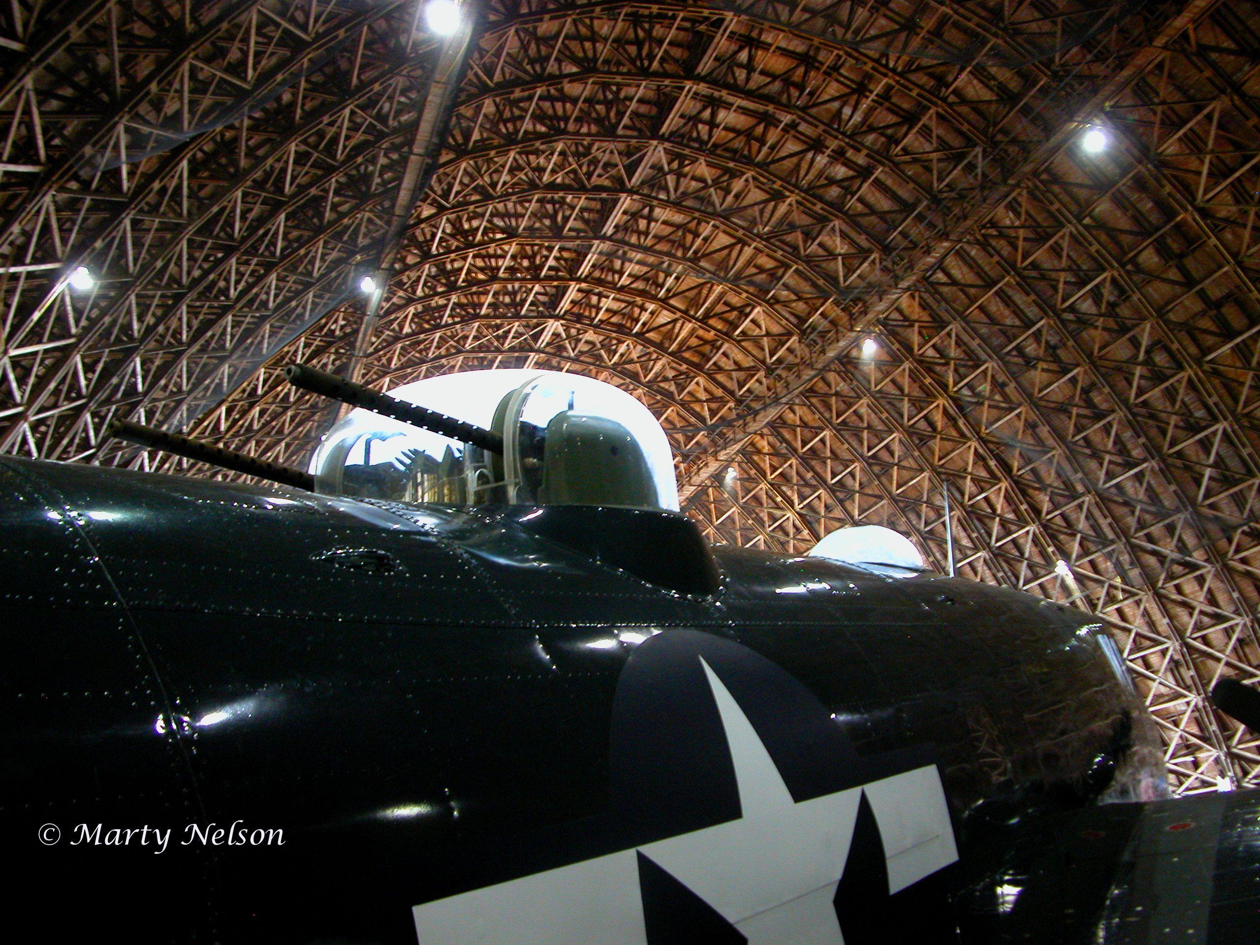 Fighter plane with guns, Tillamook Air Museum, Oregon. NOT