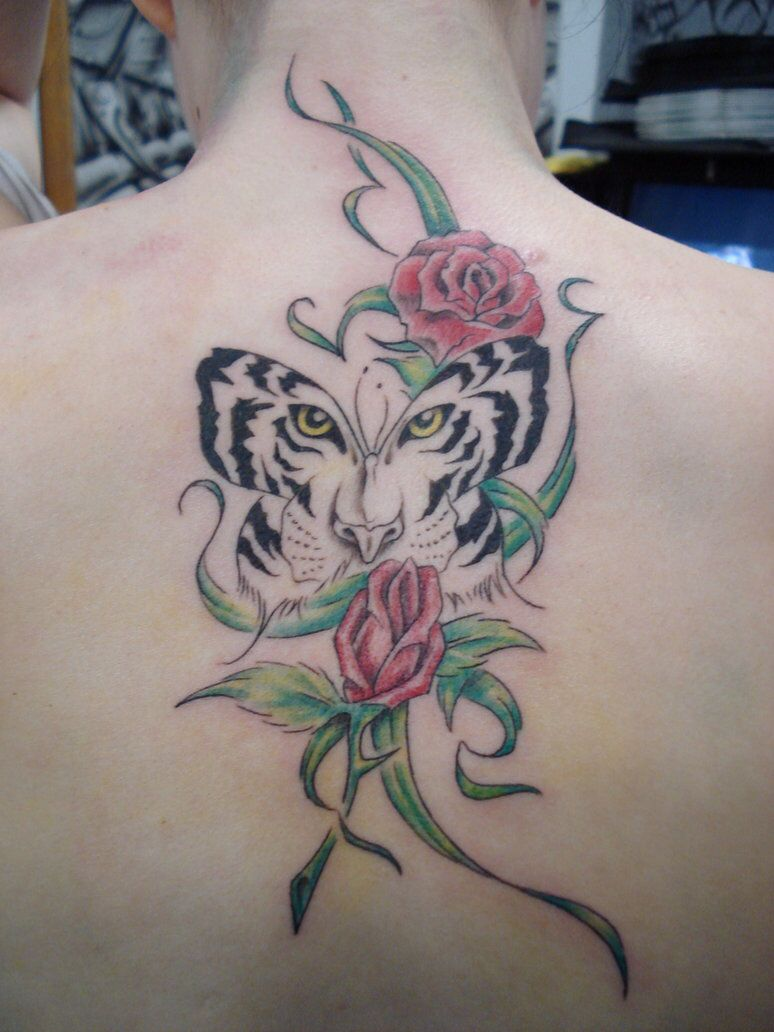 Tigger tattoo designs - This Would Be Cool If I Could Have Tigger S Picture With The Rose Embellisments Rather Than The White Tiger