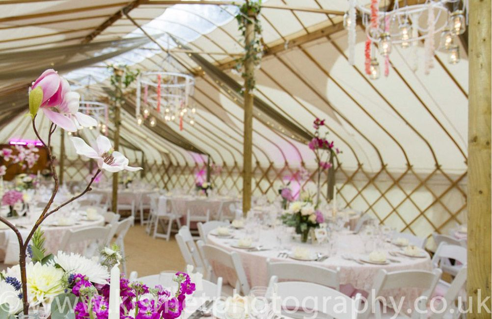 Real wedding styled by www.verdigrisvenuedressing.co.uk I maison jar lights I pearl, flower petal string and cut glass crystal chandelier I long yurt I taupe organza drapes I Fairy Lights I Vintage Cut Glass table centres I pink and lace table cloths