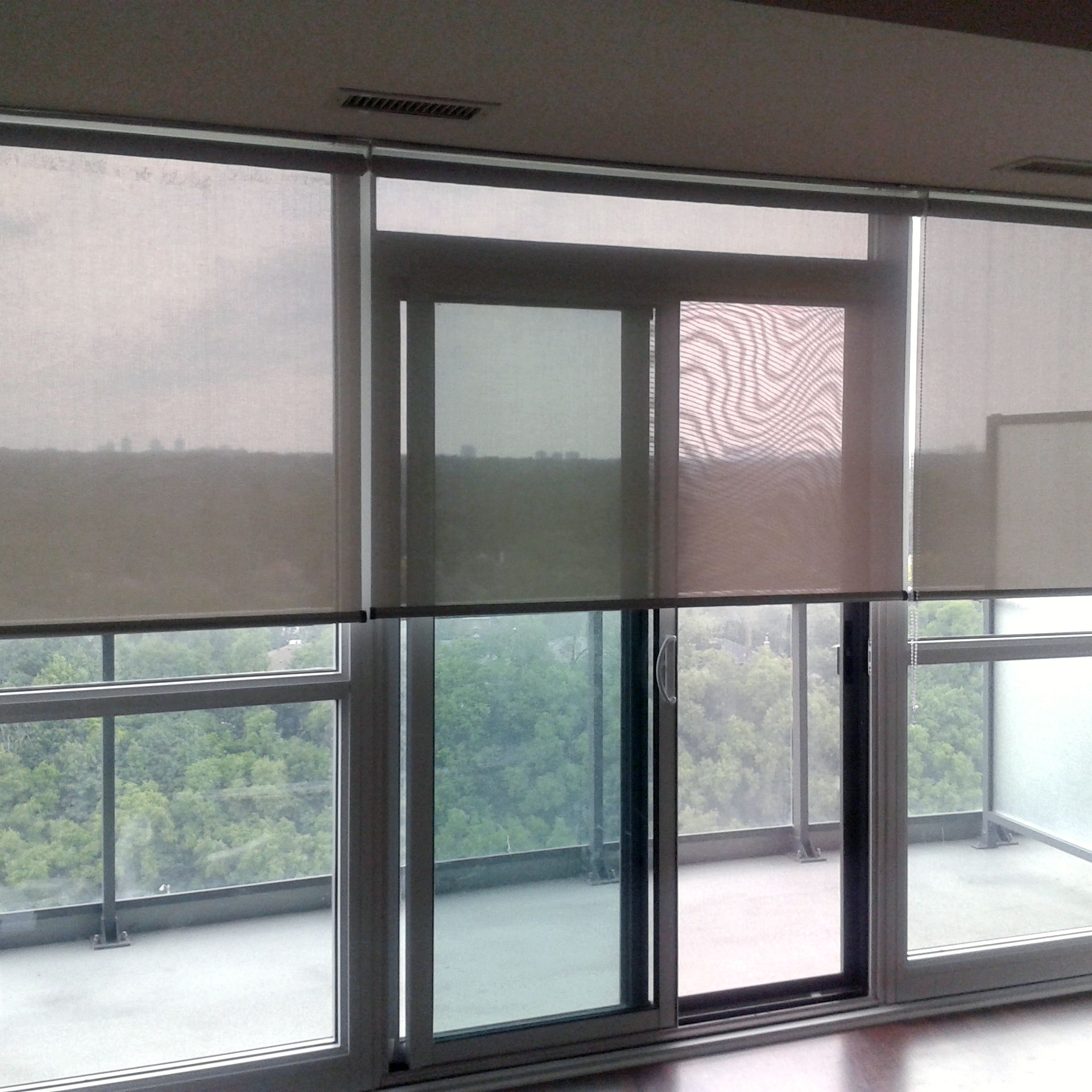 Roller screen with full view condo windows