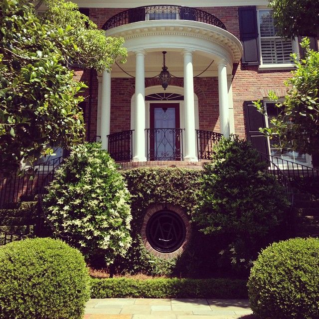 Southern entryway in Charleston, SC with a double stair and columns