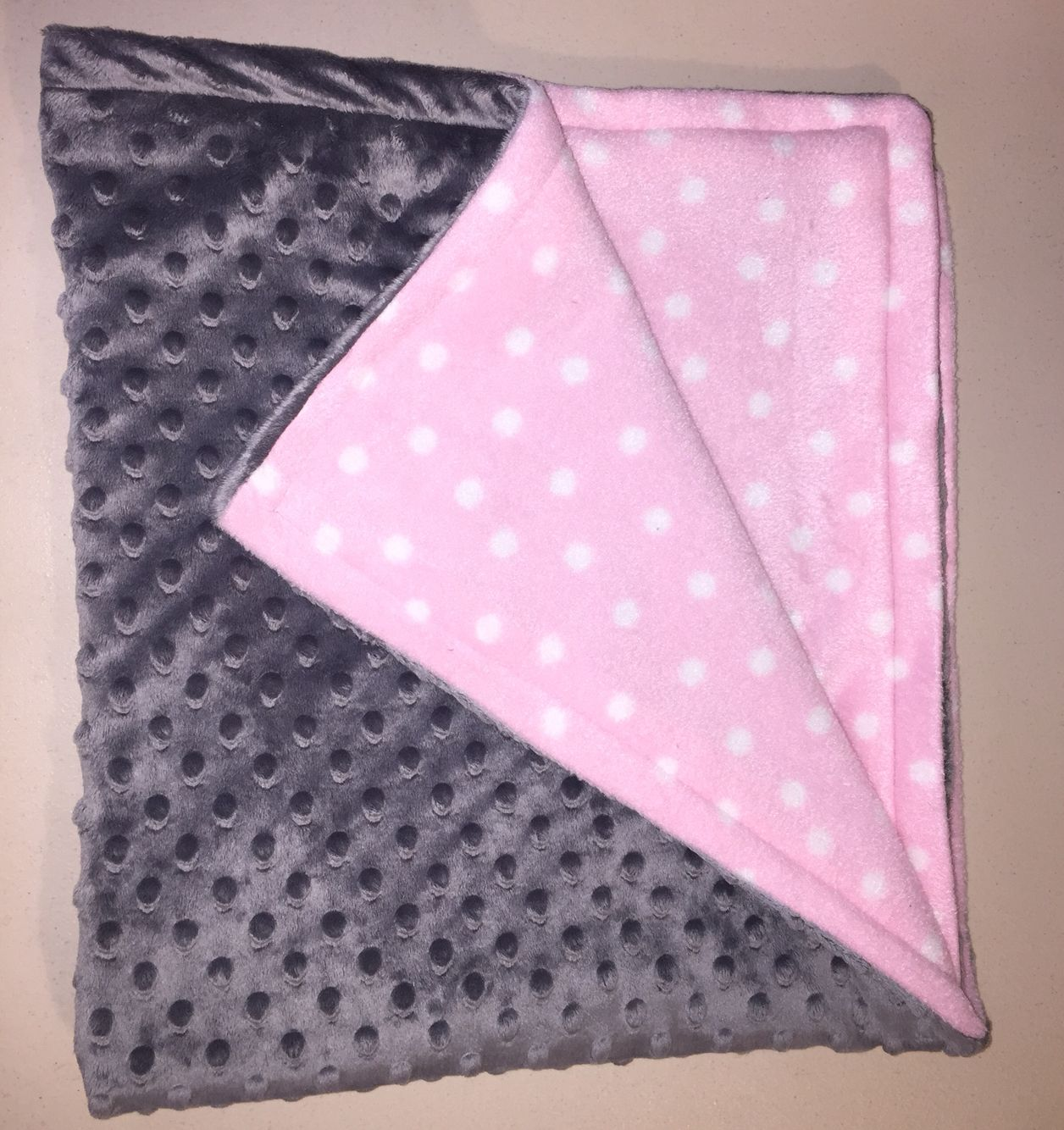 Minky and fleece baby blanket made with help from my year old