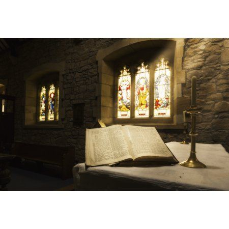 An open Bible on display in a church with colourful stained glass windows Bamburgh Northumberland England Canvas Art - John Short Design Pics (19 x 12)