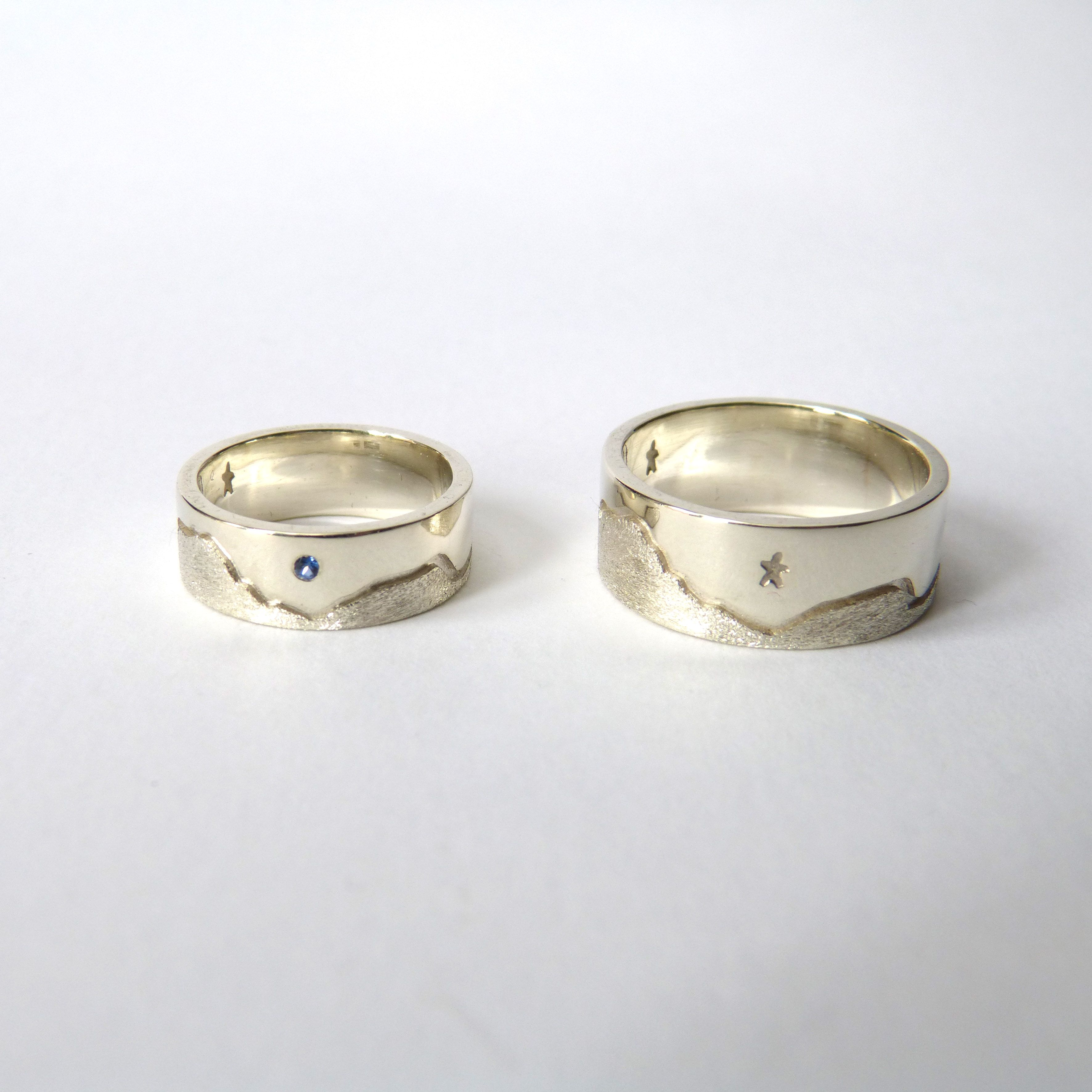 9ct white gold wedding rings featuring the couple\'s favourite ...