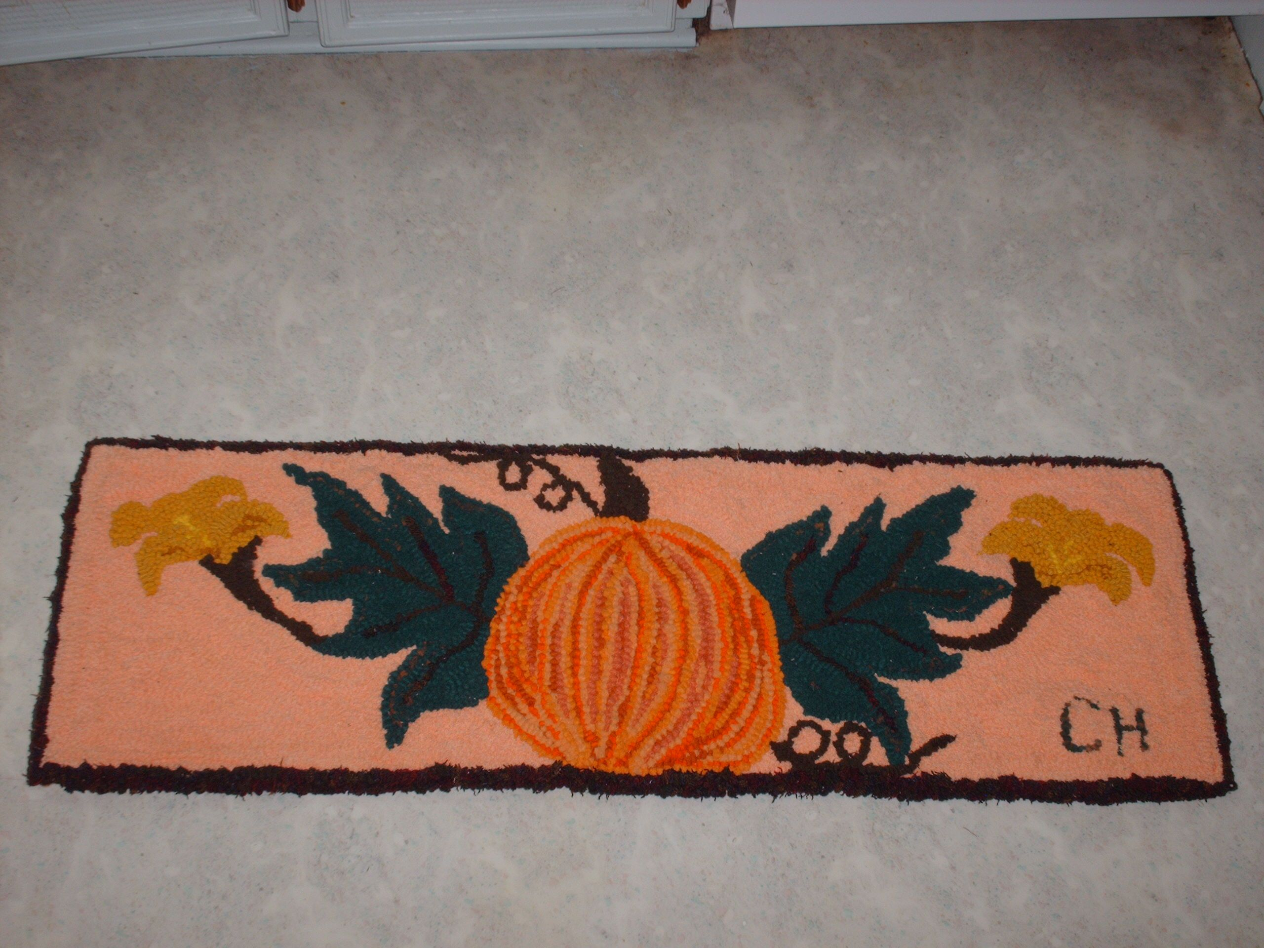"""40""""x13"""" pad for my deacons bench.  The background is terrycloth.  Made by Carmen Hall using Rug Crafters tool Finished October 2015"""