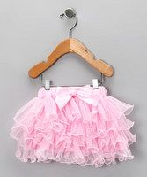 Keep little princess' precious posterior pretty with this cotton-lined tutu. With ruffle details that loop and swoop their way around the skirt, it adds some—or even more—frilly flair to Her Majesty's wardrobe, which is all about function and fun.Cotton / polyesterHand wash; hang dryImported