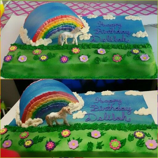Rainbow with Unicorn 12x18 sheet cake the rainbow is made with an 8
