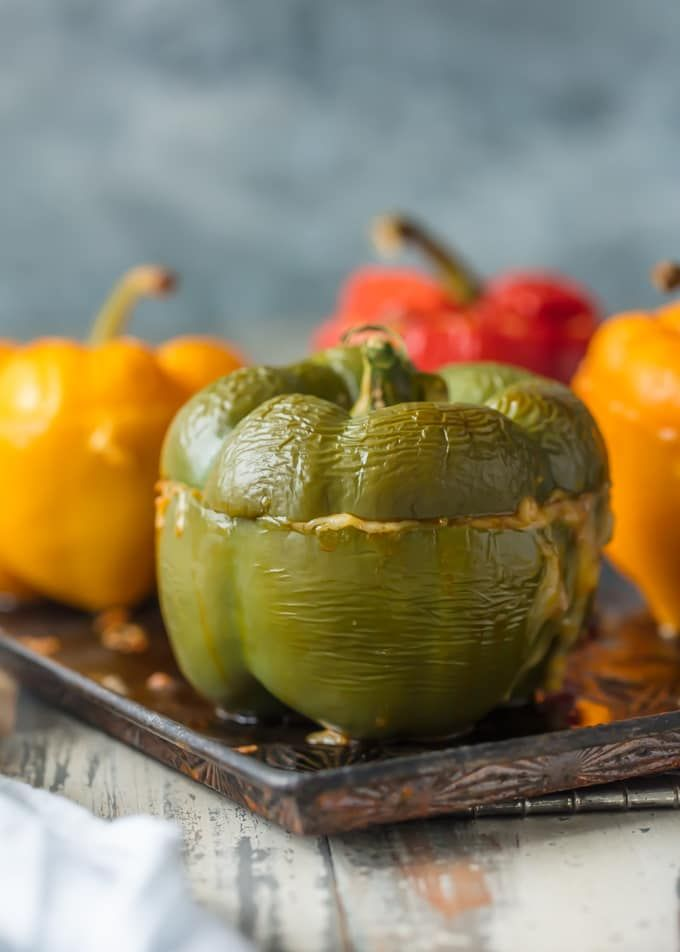Cheesy Enchilada Stuffed Peppers Are Our Go To Easy Dinner Recipe These Bell Peppers Are Stuffed With Beef Stuffed Peppers Peppers Recipes Cheesy Enchiladas