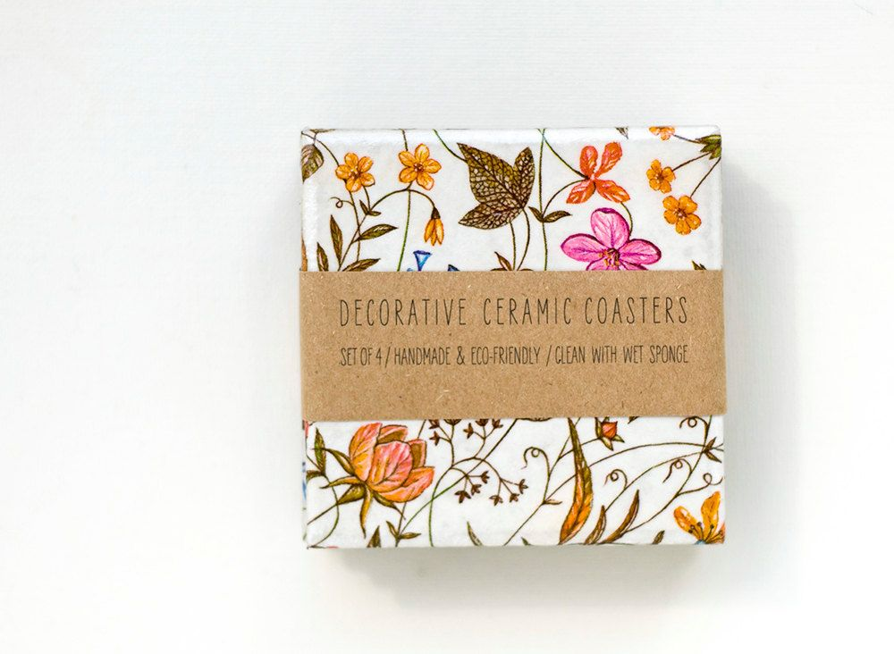 For the person who throws charming garden parties: Small Autumn Flowers ceramic coasters, set of 4. $25.00, via Etsy.
