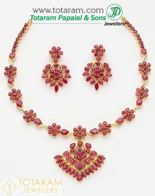 28f5043e72 22 Karat Gold Ruby Necklace & Long Earrings set with intricate workmanship.  Gross Gold Weight: 41.600 - 42.600 grams Ruby Weight : 26.0 Carats Length  of ...