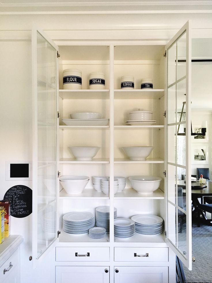 kitchen storage, glass cabinets, bowls, plates, white ...