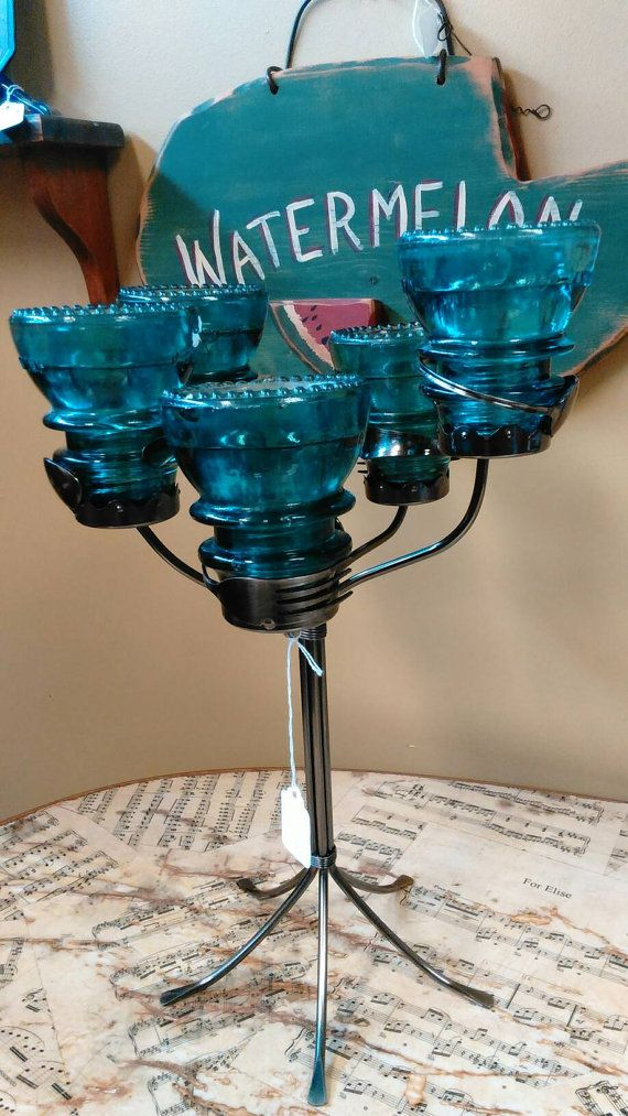 Check out this item in my Etsy shop https://www.etsy.com/listing/474821123/insulator-and-silverware-candelabra-one