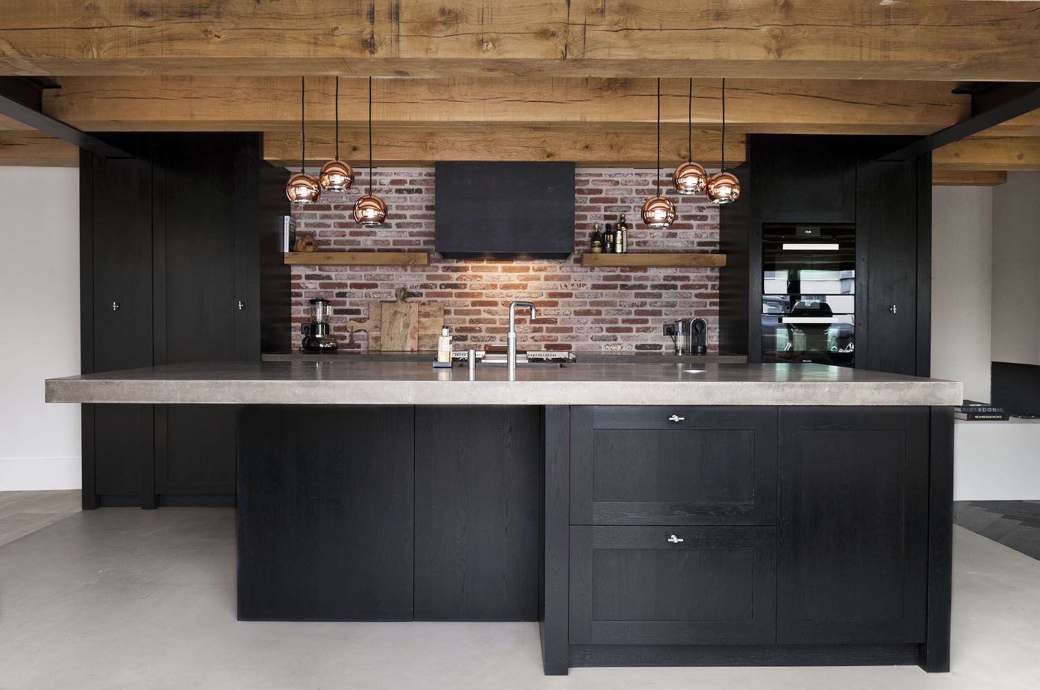 Modern, rustic kitchen with black espresso cabinets, exposed brick ...