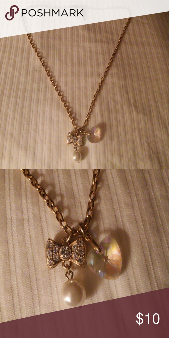 Betsy Johnson Bowtie Necklace Cute rhinestone bow with faux pearl dangle and faceted heart charm make up this new Betsy Johnson necklace. Metal is gold tone.  Never worn. Betsey Johnson Jewelry Necklaces