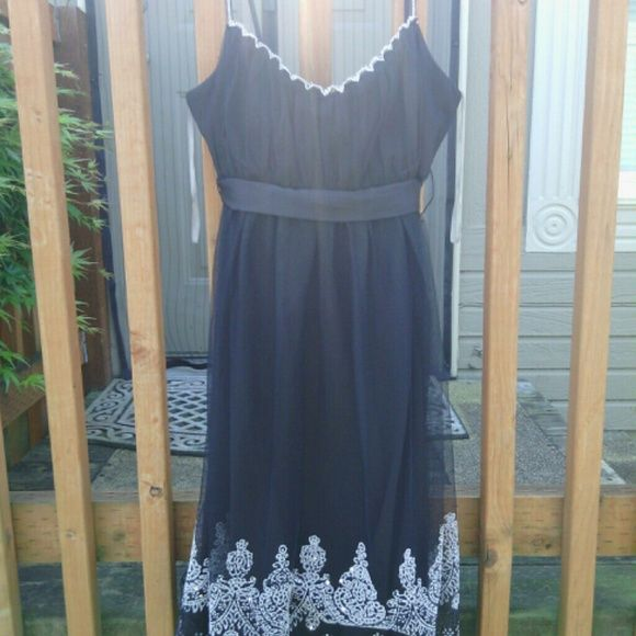 Love Tease Black Tulle Dress With Beaded Detail This lovely dress is a dark black with silver beaded embellishments. A few of the bead have fallen off, but overall the dress is in great condition. I love it but I don't think I will ever wear it. Willing Bundle or consider offers! Comment with any questions! Love Tease Dresses